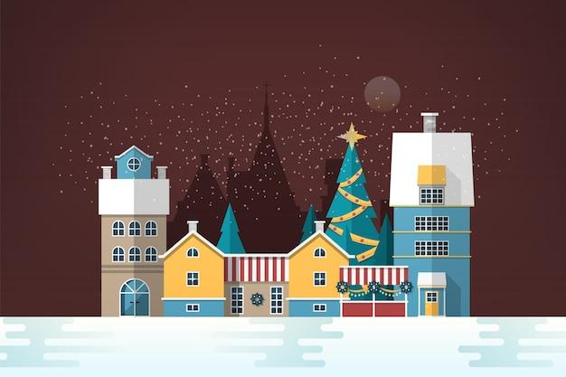 Paisaje de noche nevada con pequeña ciudad europea
