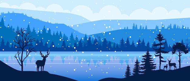Paisaje panorámico de navidad de invierno con nieve, renos, colinas, contorno de bosque, lago congelado