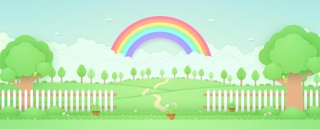 Paisaje de primavera, árboles en la colina, arco iris en el skygarden con maceta de flores sobre el césped