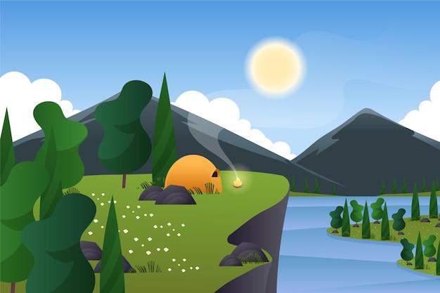 Paisaje primaveral con camping en carpa y montañas.