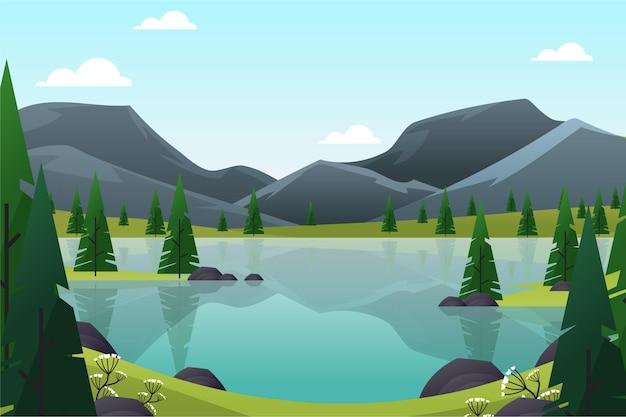 Paisaje primaveral con montañas y lago.
