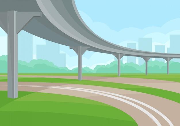 Paisaje urbano con paso elevado, camino y pasto verde