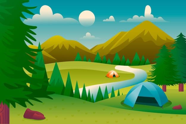Paisaje de zona de acampada con carpas y montañas.