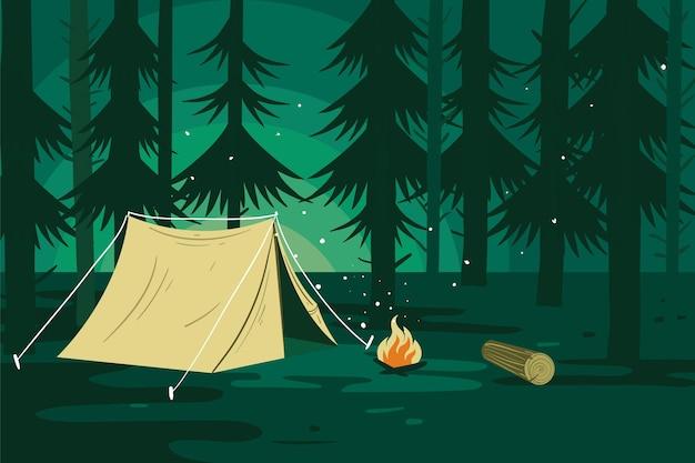 Paisaje de zona de camping con bosque.