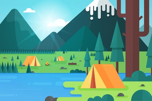 Paisaje de zona de camping con carpa y árboles.