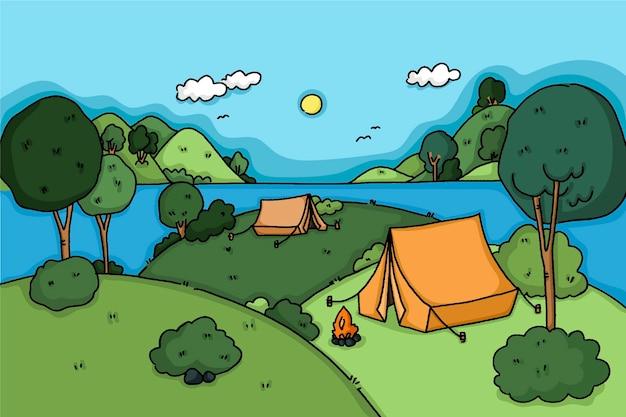 Paisaje de zona de camping con colinas.