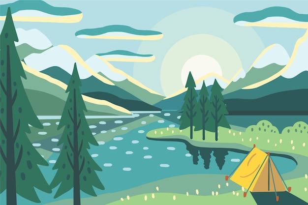 Paisaje de zona de camping con tienda y lago.