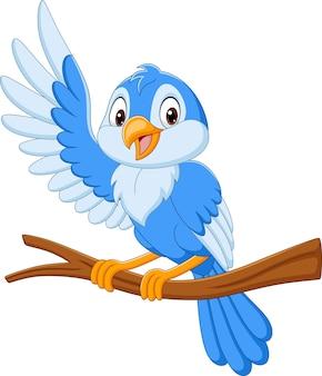 Pájaro azul de dibujos animados ondeando en la rama de un árbol