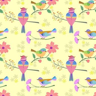 Pájaro en rama con flores de patrones sin fisuras.