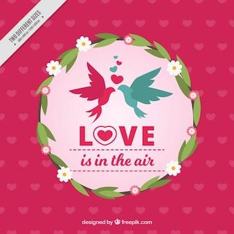 Pájaros enamorados en una corona floral