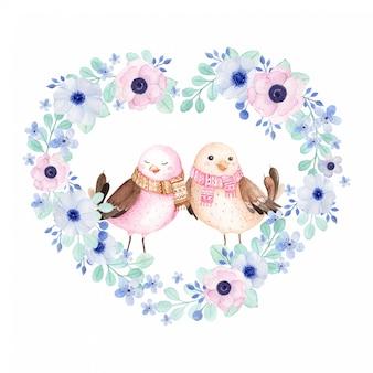 Pájaros enamorados en guirnalda floral en forma de corazón