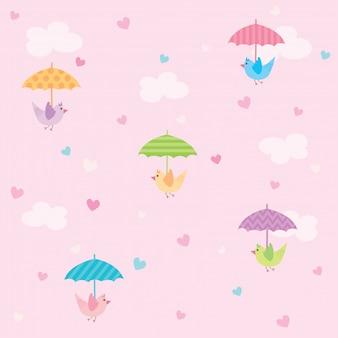 Pájaros con patrón sin fisuras de corazón lloviendo