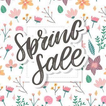 Palabra de venta de primavera colgando de las hojas con cuerdas. flores de la ilustración