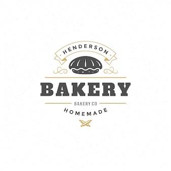 Panadería logo o insignia vintage vector ilustración tarta silueta para panadería