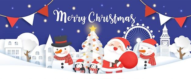 Pancarta navideña con papá noel, muñeco de nieve y pingüinos en el estilo artesanal y cortado de papel de la aldea de nieve.