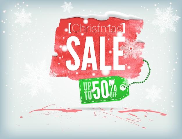 Pancarta navideña con tinta con una etiqueta de compra y copos de nieve