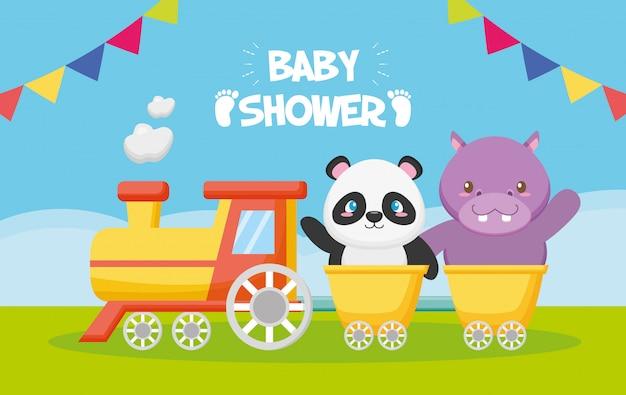 Panda y hipopótamo en un tren para tarjeta de baby shower