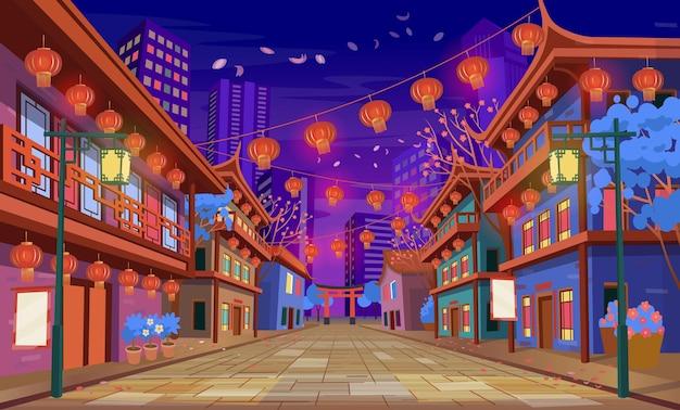 Panorama de la calle china con casas antiguas, linternas de arco chino y una guirnalda