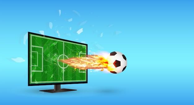 Pantalla agrietada televisión con fútbol y fuego sobre la pantalla
