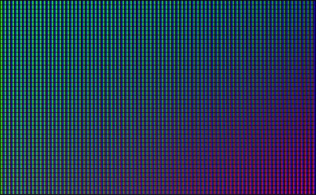 Pantalla de video de pared con luces de punto verde, azul y rojo sobre fondo negro.