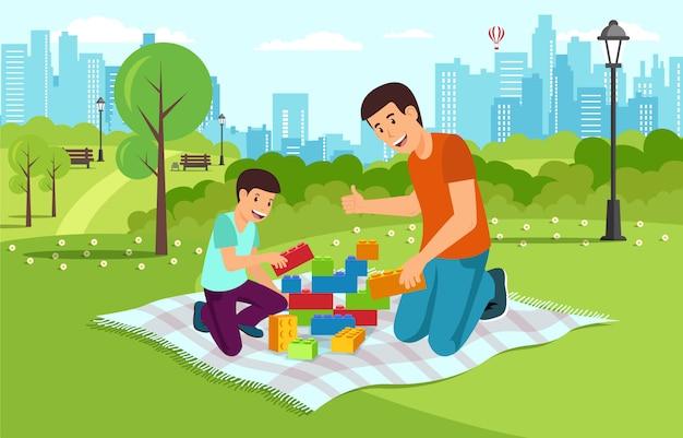 Papá de dibujos animados con el hijo en el parque recoger constructor.