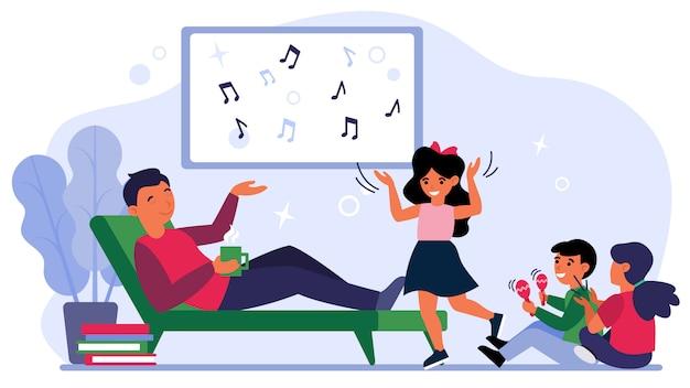 Papá disfrutando de la música con niños