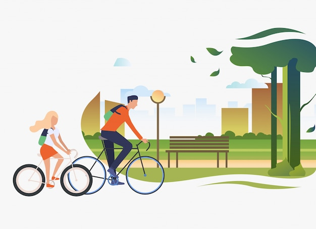 Papá e hija montando bicicletas, parque de la ciudad con árbol y banco