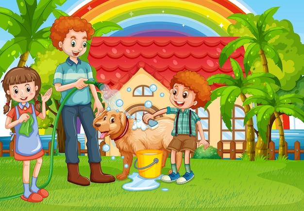 Papá e hijos dando un baño a perro