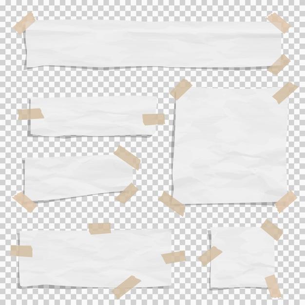 Papel blanco rasgado piezas de diferentes tamaños con grifo pegajoso.