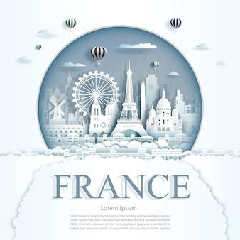 Papel cortado monumentos de francia con globos de aire caliente y plantilla de fondo de nubes