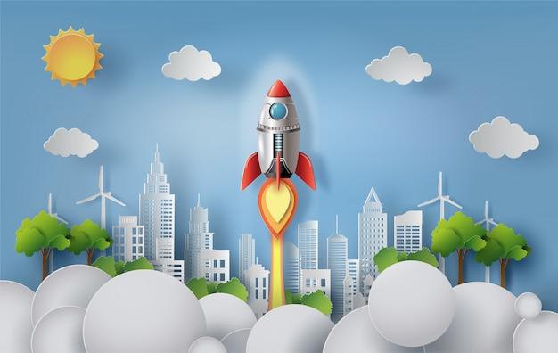 Papel estilo art del cohete volando sobre la ciudad moderna