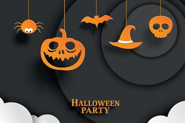 Papel naranja halloween colgando en el fondo oscuro