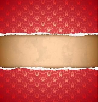 Papel pintado ornamental rojo rasgado