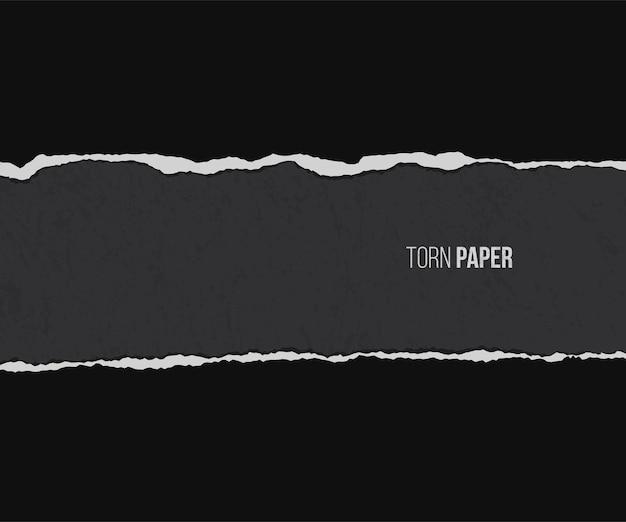 Papel rasgado con sombra aislada sobre fondo negro grunge.