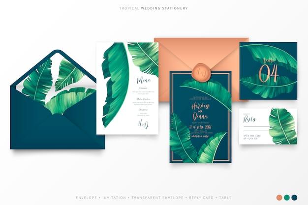 Papelería de boda tropical con elegantes hojas de palmera