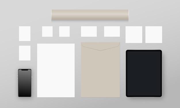 Papelería comercial. papel, tarjetas de visita, tarjetas, sobres, smartphone, tableta, tubo de papel. conjunto de plantillas de identidad corporativa. realista