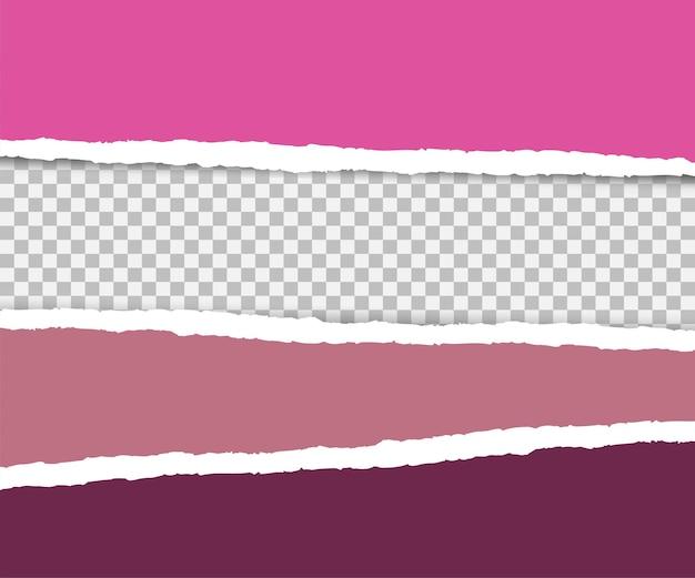 Papeles rosados rasgados en diferentes tonos.