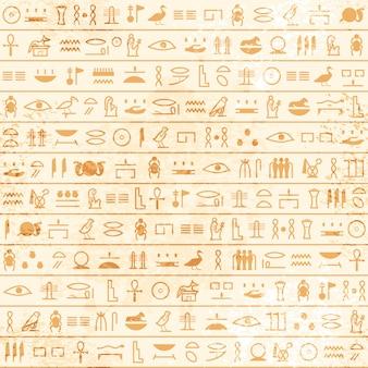 Papiro egipcio antiguo con patrones sin fisuras de jeroglíficos. patrón de vector histórico del antiguo egipto.