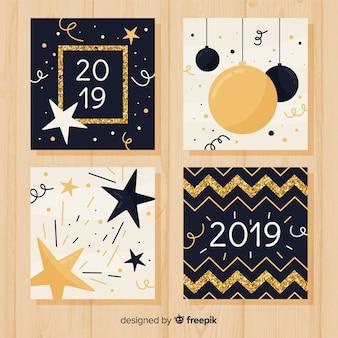 Paquete tarjetas año nuevo purpurina dorada