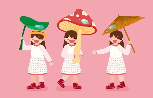 Paquete con tres niñas sosteniendo hojas, setas y paraguas en día lluvioso sobre fondo rosa en personaje de dibujos animados