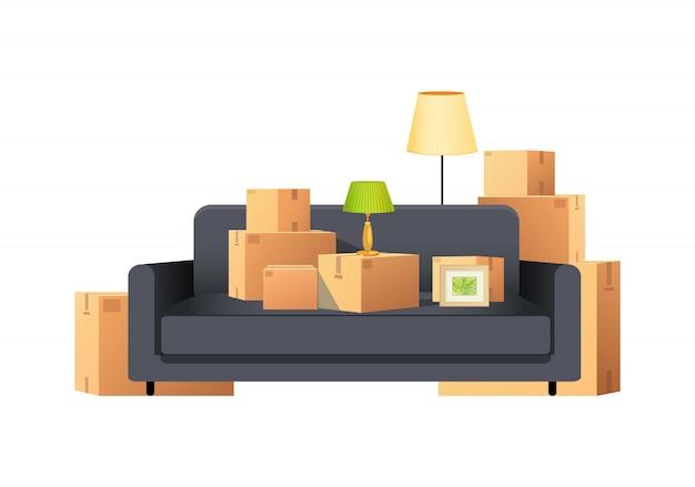 Paquetes de paquetes de cajas de cartón con sofá y lámpara vector