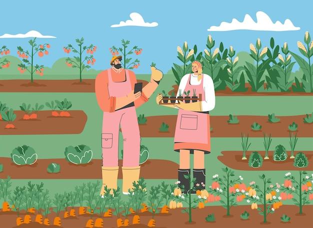 Par de agricultores de pie en el huerto