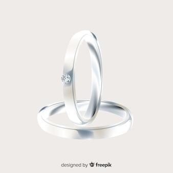 Par de anillos de boda realistas plateados