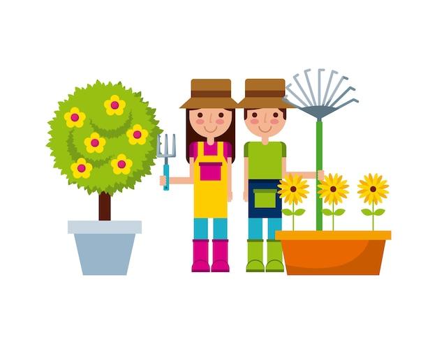 Par de jardineros con hermosas flores