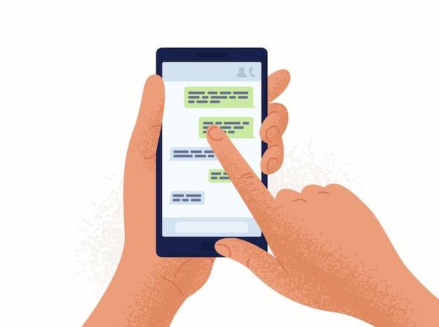 Par de manos sosteniendo teléfono inteligente o teléfono móvil con aplicación de chat o mensajería en pantalla