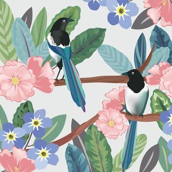 Un par de pájaros en el bosque tropical botánico.