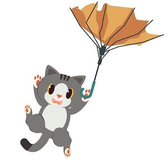 El paraguas roto con un conjunto gato. el gato que sostiene un paraguas roto. el gato parece asustado