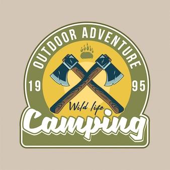 Parche vintage con patas de vida silvestre de oso pardo y dos viejos signos cruzados de hacha. aventura, viaje, campamento de verano, al aire libre, viaje.
