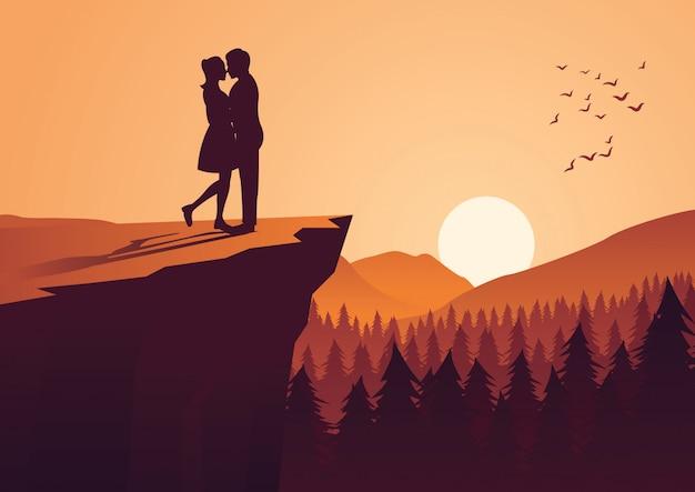 Pareja abrazo juntos en el acantilado