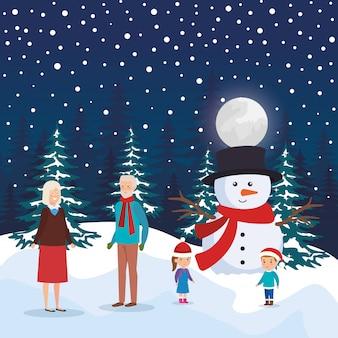 Pareja de abuelos con niños y muñeco de nieve en paisaje nevado